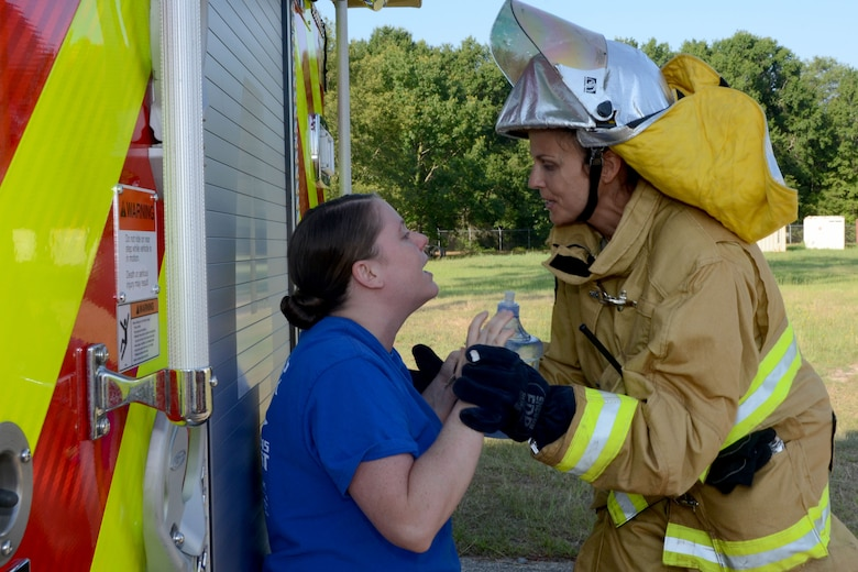 U.S. Air Force Staff Sgt. Lisa Elders tries to calm Tech. Sgt. Jessica Gilbert, a health systems technician with the 169th Medical Group, after a simulated crash during a mass casualty exercise at McEntire Joint National Guard Base, S.C., June 18, 2015. McEntire Joint National Guard Base simulated a vehicle collision on base to offer personnel real-world training should an event ever occur in a real world capacity. (South Carolina Air National Guard photo by Amn Megan Floyd/Released)