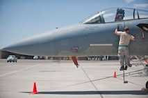 A maintainer assigned to the 159th Maintenance Squadron, Louisiana Air National Guard, inspects a component on an F-15 Eagle during Red Flag 15-3 at Nellis Air Force Base, Nev., July 14, 2015. Red Flag provides a series of intense air-to-air scenarios for aircrew and ground personnel to increase their combat readiness and effectiveness for future real-world operations. (U.S. Air Force photo by Staff Sgt. Siuta B. Ika)