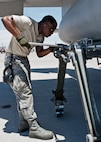 Senior Airman Quenton Richardson, 159th Maintenance Squadron crew chief, Louisiana Air National Guard, removes an external fuel tank on an F-15 Eagle during Red Flag 15-3 at Nellis Air Force Base, Nev., July 14, 2015. Crew chiefs are responsible for overseeing the day-to-day maintenance of aircraft including diagnosing malfunctions and replacing components to ensure the aircraft functions properly. (U.S. Air Force photo by Airman 1st Class Jake Carter)