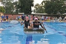 Airman 1st Class Jessica Gearheart, 39th Logistics Readiness Squadron supply journeyman, and Airman 1st Class Ladarius Crenshaw, 39th  Communications Squadron commander's support staff journeyman, race across the base pool during the 2nd Annual Cardboard Cup Race July 10, 2015, at Incirlik Air Base, Turkey. Based on bracket elimination, awards were given out for the fastest two and four person boat, as well as, the Titanic award, for the boat that sank the fastest. (U.S. Air Force photo by Senior Airman Michael Battles/Released)