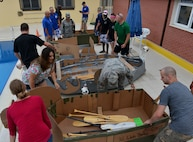 Participants of the Cardboard Cup Race prepare their boats July 10, 2015, at Incirlik Air Base, Turkey. This is the second time the event has been held at Incirlik. (U.S. Air Force photo by Senior Airman Michael Battles/Released)