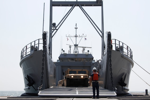 The ramp on the Landing Craft Utility 2000 is lowered and unloading of vehicles begins at Anmyeon Beach on the west coast of the Republic of Korea. CJLOTS 2015 is an exercise designed to train U.S. and ROK service members to accomplish vital logistical measures in a strategic area while strengthening communication and cooperation in the U.S. - ROK Alliance. (U.S. Army photo by Sgt. Thanh Pham)
