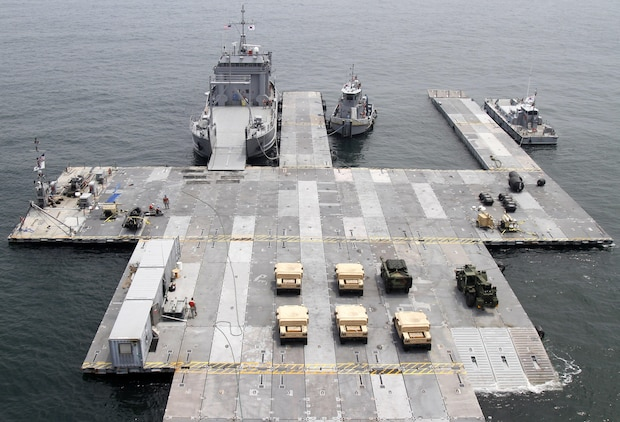 A Roll-on Roll-off Discharge Facility is attached to the USNS 2nd Lt. John P. Bobo (T-AK 3008) during the Combined Joint Logistics Over-the-Shore exercise off the shore of Anmyeon Beach, Republic of Korea, July 1, 2015. CJLOTS 2015 is an exercise designed to train U.S. and ROK services members to accomplish vital logistical measures in a strategic area while strengthening communication and cooperation in the U.S.-ROK Alliance. (U.S. Army photo by Staff Sgt. Chris Perkey)