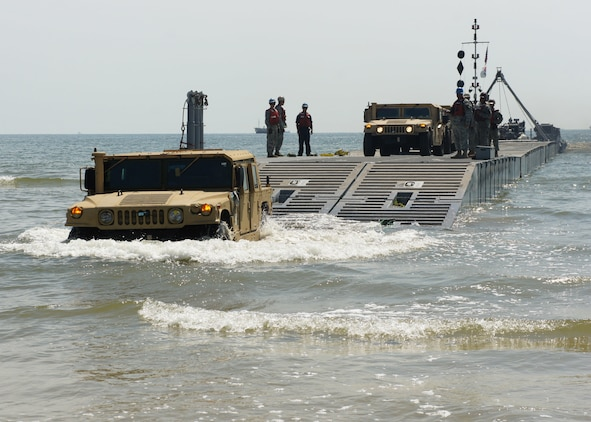 ANMYEON BEACH, Republic of Korea (July 3, 2015) – U.S. Marines from the 3rd Marine Expeditionary Force drive High Mobility Multipurpose Wheeled Vehicles (HMMWV) to the beach from a Causeway ferry operated by the 331st Transportation Company at Anmyeon Beach on the west coast of the Republic of Korea during exercise Combined Joint Logistics Over-the-Shore (LOTS) 2015.  CJLOTS 2015 is an exercise designed to train U.S. and ROK service members to accomplish vital logistical measures in a strategic area while strengthening communication and cooperation in the U.S.-ROK Alliance.  (U.S. Navy Photo by LT Russell Wolfkiel/Released)