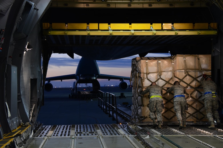 APEX students offload a pallet of household goods July 7, 2015 onto a 60K tunner at Travis Air Force Base, California. Students were required to complete a minimum of 36 hours of hands-on training as part of the APEX training course. (U.S. Air Force photo by Airman 1st Class Amber Carter)
