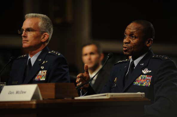 Gen. Paul J. Selva, the nominee for vice chairman for the Joint Chiefs of Staff, and Gen. Darren W. McDew, the nominee for U.S. Transportation Command commander, sit before Congress to testify for their future positions during their nomination hearing July 14, 2015. Both were nominated by President Barack Obama and expressed their gratitude for the nomination, and if selected look forward to working together with Congress, the Defense Department, and other branches of the government and military. (U.S. Air Force photo/Senior Airman Hailey Haux)