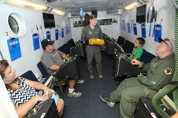Maj. Jennifer Giovannetti, 359th Aerospace Medicine Squadron night vision goggle academic instructor course and aerospace and operational physiology flight commander, speaks to Jared Stadler, 560 th Flying Training Squadron pilot for a day, and his family in an altitude chamber July 17, 2015, at Joint Base San Antonio-Randolph. As part of being pilot for a day, Stadler was given a flight suit and patches and spent the day learning what it's like to be an Air Force pilot. (U.S. Air Force photo by Melissa Peterson/Released)