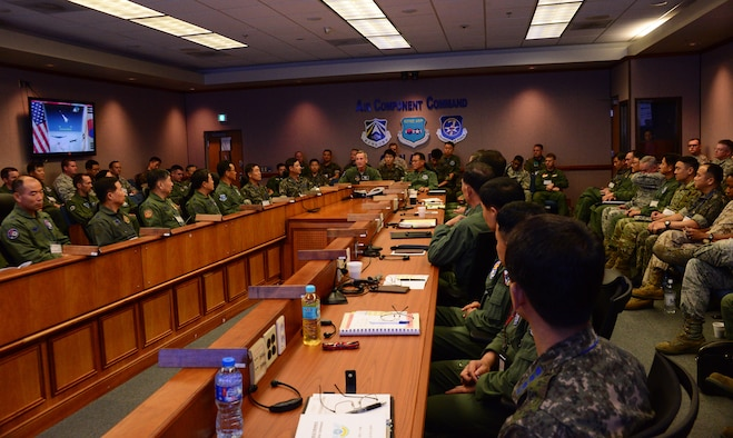 Senior leaders from the U.S. and Republic of Korea air forces meet during the 2015 Air Boss Conference on Osan Air Base, ROK, July 17, 2015. The annual conference, hosted by the commander of the Air Component Command, is a bi-lateral forum between U.S. and ROK forces under the combined forces aegis on the peninsula. The conference plays a vital role in bringing together commanders from both on and off the peninsula -- commanders who each support a potential crisis or conflict in the ROK with forces. (U.S. Air Force photo by Senior Airman Kristin High/Released)