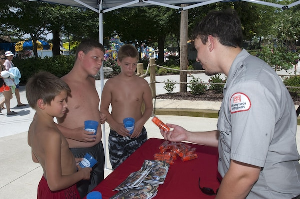 J. Percy Priest Lake Park Ranger Adam Johnson hands out water safety goodies and provides information at Nashville Shores Lakeside Resort July 10, 2015.  The Corps is setting up a booth every Friday from noon to 2 p.m. to pass out water safety goodies and to talk with families about wearing life jackets when recreating at the park and lake.