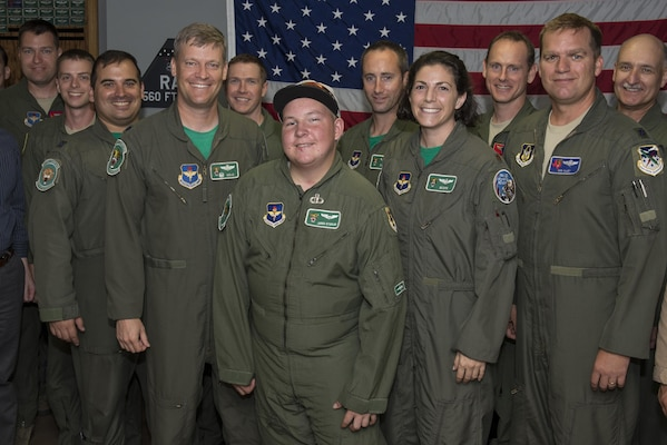 """Jared Stadler,560th Flying Training Squadron pilot for a day, stands with members of the 560th FTS July 17, 2015, at Joint Base San Antonio-Randolph. The """"Pilot for a Day"""" program helps give children with chronic illnesses a break from the challenges they face each day by showing them what it is like to be an Air Force pilot.(U.S. Air Force photo by Airman 1st Class Stormy Archer/Released)"""
