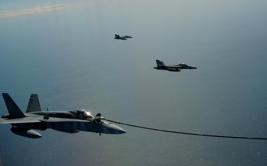 A Royal Australian Air Force KC-30A Multi Role Tanker Transport refuels a RAAF F/A-18 Hornet during a refueling training exercise as part of Talisman Sabre 2015 near Darwin, Australia, July 13, 2015. U.S. and Australian forces are conducting air refueling missions throughout the Talisman Sabre 2015 exercise to improve interoperability and familiarization with each other's procedures.Talisman Sabre is a biennial exercise that provides an invaluable opportunity for nearly 30,000 U.S. and Australian defense forces to conduct operations in a combined, joint and interagency environment that will increase both countries' ability to plan and execute a full range of operations from combat missions to humanitarian assistance efforts. (U.S. Air Force photo by Staff Sgt. Alexander Martinez/Released)