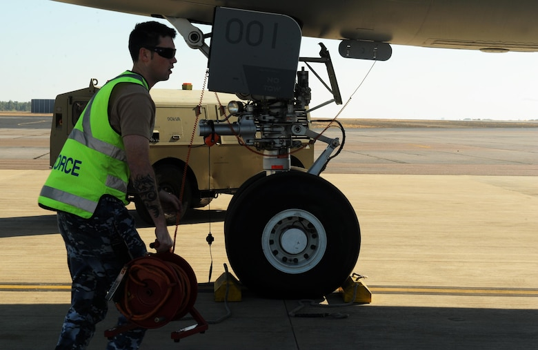 Royal Australian Air Force Leading Aircraftman Nick Hodkinson, an avionics technician with the No. 33 Squadron, prepares a KC-30A refueler for takeoff July 13, 2015 at RAAF Darwin, Australia. U.S. and Australian forces are conducting air refueling missions throughout the Talisman Sabre 2015 exercise to improve interoperability and familiarization with each other's procedures. Talisman Sabre is a biennial exercise that provides an invaluable opportunity for nearly 30,000 U.S. and Australian defense forces to conduct operations in a combined, joint and interagency environment that will increase both countries' ability to plan and execute a full range of operations from combat missions to humanitarian assistance efforts. (U.S. Air Force photo by Staff Sgt. Alexander Martinez/Released)