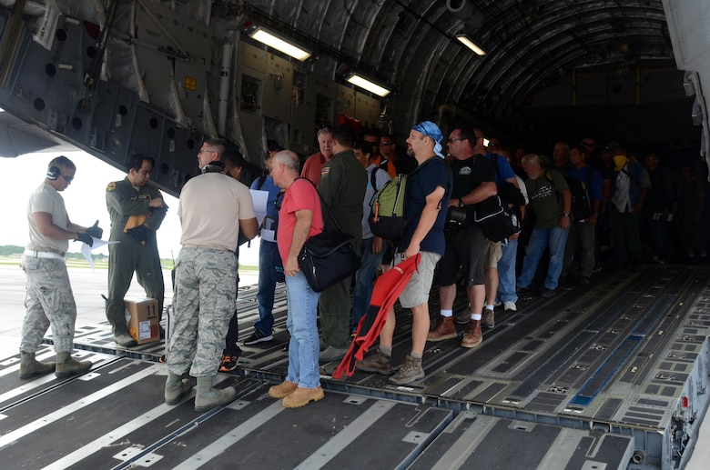 More than 125 Department of Defense members and contractors arrive at Andersen Air Force Base, Guam, July 15, 2015, after evacuation from Wake Island in preparation for potential surges caused by Typhoon Halola. An evacuation mission such as this highlights Pacific Air Force's flexibility to generate air response quickly across the theater, which is a key component to air power. (U.S. Air Force photo by Airman 1st Class Alexa A. Henderson/Released)