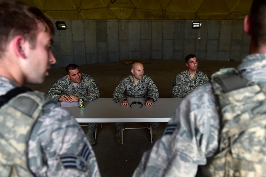 460th Security Forces Squadron Delta Flight members demonstrates their knowledge of Security Forces in front of a panel of experts during Flight of the Quarter competition July 16, 2015, on Buckley Air Force Base, Colo.  The competition is designed to test the Defenders' expeditionary skills and build camaraderie within the flights. (U.S. Air Force photo by Staff Sgt. Stephany Richards/RELEASED)