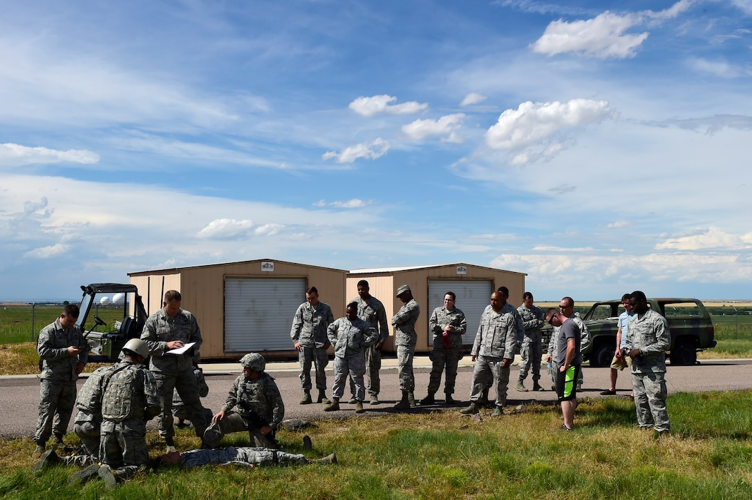 460th Security Forces Squadron Delta Flight members perform self-aid and buddy care during the Flight of the Quarter competition July 16, 2015, on Buckley Air Force Base, Colo.  The competition is designed to test the Defenders' expeditionary skills and build camaraderie within the flights. (U.S. Air Force photo by Staff Sgt. Stephany Richards/RELEASED)
