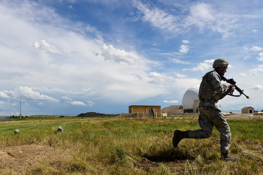 460th Security Forces Squadron Delta Flight members compete in the Flight of the Quarter competition July 16, 2015, on Buckley Air Force Base, Colo.  The competition is designed to test the Defenders' expeditionary skills and build camaraderie within the flights. (U.S. Air Force photo by Staff Sgt. Stephany Richards/RELEASED)