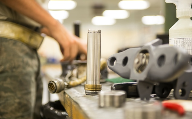 An ejector piston rests on the table before being installed into a bomb rack during the 23d Equipment Maintenance Squadron's dedicated weekend duty July 11, 2015, at Moody Air Force Base, Ga. The 23d EMS's dedicated weekend duty crew is designed to ensure A-10C Thunderbolt II phase inspections are complete on time while alleviating stress on Airmen. (U.S. Air Force photo by Airman 1st Class Ceaira Tinsley/Released)