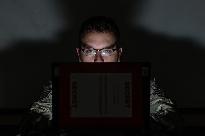 U.S. Air Force Staff Sgt. Kyle Baker, active associate Intel analyst with the 169th Operations Support Squadron, views a computer screen at McEntire Joint National Guard Base, S.C. June 14, 2015.  