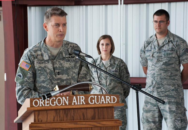 Oregon Army National Guard Maj. Gen. Daniel R. Hokanson, Adjutant General, Oregon, discusses the role of the 142nd Fighter Wing with regard to its Aerospace Control Alert mission during the official ribbon cutting ceremony for the new alert barn at the Portland Air National Guard Base, Ore., July 10. The 142 Fighter Wing is tasked with protecting the skies over the Pacific Northwest, from northern California to the Canadian border, and extending out along the Pacific coastline. (U.S. Air National Guard photo by Tech. Sgt. John Hughel, 142nd Fighter Wing Public Affairs/Released)