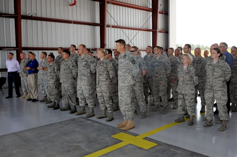 Attendees and staff of the Portland Air National Guard Base, Ore., listen to remarks during the official ribbon cutting ceremony for a new alert barn on base July 10, 2015. (U.S. Air National Guard photo by Tech. Sgt. John Hughel, 142nd Fighter Wing Public Affairs/Released)