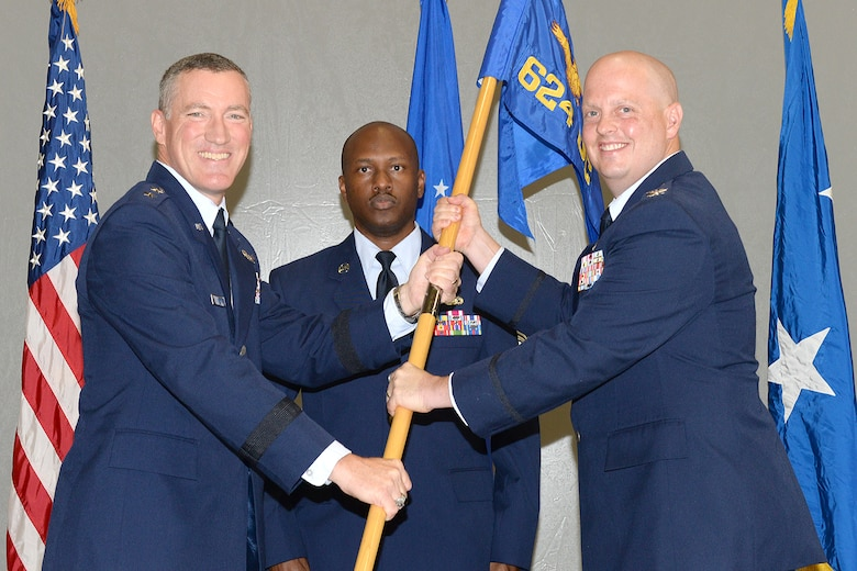 Col. Michael P. Dombrowski (right) accepts the 624th Operations Center guidon from Maj. Gen. Ed Wilson, 24th Air Force commander during a change of command ceremony July 1, 2015 at Joint Base San Antonio-Lackland, Texas. The 624 OC's mission is to establish, plan, direct, coordinate, assess, command and control full spectrum cyberspace operations and capabilities to support Air Force and joint requirements. (U.S. Air Force photo by Benjamin Faske/Released)