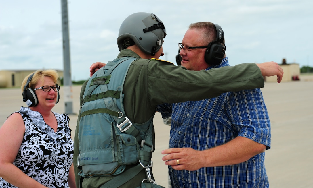 Air Force Staff Sgt. Brian Schroeder, 509th Aircraft Maintenance Squadron dedicated crew chief, hugs his father after finishing his B-2 Spirit incentive flight at Whiteman Air Force Base, Mo., July 10, 2015. Schroeder was awarded an incentive flight in the B-2 Spirit for being named the 2014 Air Force Global Strike Command Crew Chief of the Year. (U.S. Air Force photo by Senior Airman Joel Pfiester/Released)