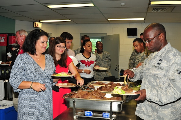 Deploying members of the 172d Airlift Wing's Civil Engineering Squadron and their families were treated to a 'send-off' steak dinner by a team from the Jackson, Mississippi Outback Steakhouse.  The flavorful event was held on July 11, 2015. More than 50 members of the wing's CE squadron are deploying.