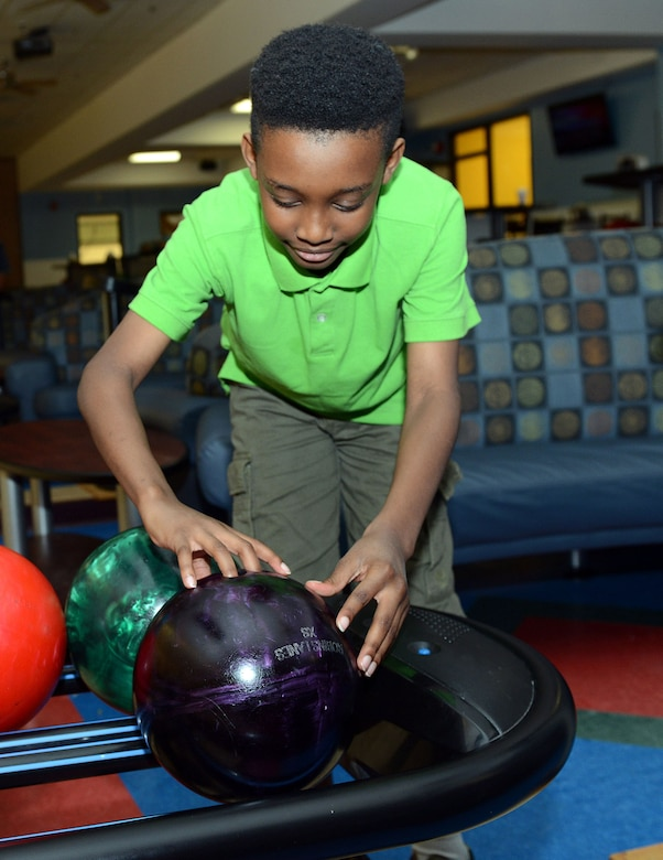 Rondell Newsome, 10, enjoys an afternoon of bowling at Robins Lanes. The bowling center is available to all active duty, retirees and their family members, Department of Defense civilians and their family members, DOD contractors and technical representatives, and guests accompanied by authorized individuals. (U.S. Air Force photo by Tommie Horton)
