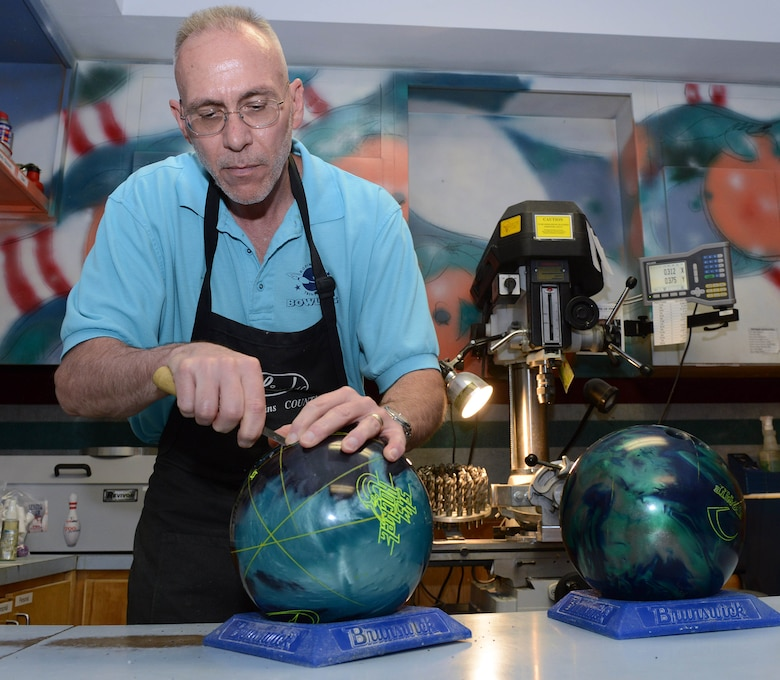 Jeff Herman, Robins Bowling Center pro shop manager, provides custom drilling service that ensures proper fitting and the most comfort for bowlers. (U.S. Air Force photo by Tommie Horton)