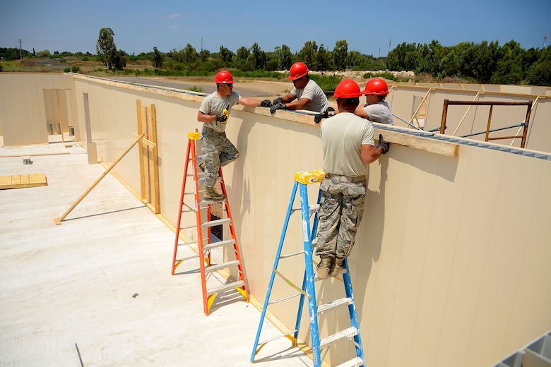 U.S. Airmen from the South Carolina Air National Guard's 169th Civil Engineer Squadron at McEntire Joint National Guard Base, S.C., construct nuform walls for multi-purpose buildings in support of a Deployment for Training in Israel, July 8, 2015. The construction project is to help S.C. PRIME BEEF Airmen maintain their civil engineering specialties. Swamp Fox civil engineers are working alongside 200th RED HORSE Squadron and U.S. Navy SEABEES civil engineers during the training exercise. (South Carolina Air National Guard photo by Tech. Sgt. Caycee R. Watson / RELEASED)