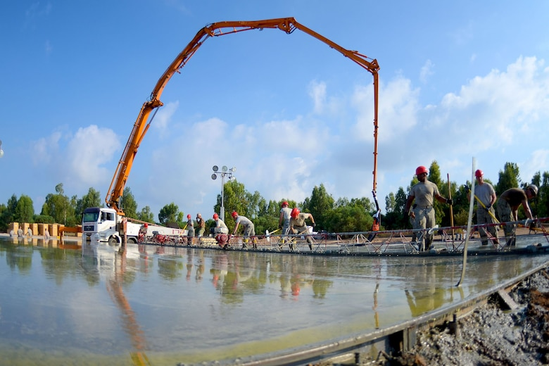 U.S. Airmen from the South Carolina Air National Guard's 169th Civil Engineer Squadron at McEntire Joint National Guard Base, S.C., pour and level concrete foundations for multi-purpose buildings being constructed in support of a Deployment for Training in Israel, June 30, 2015. The construction project is to help S.C. PRIME BEEF Airmen maintain their civil engineering specialties. Swamp Fox civil engineers are working alongside 200th RED HORSE Squadron and U.S. Navy SEABEES civil engineers during the training exercise. (South Carolina Air National Guard photo by Tech. Sgt. Caycee R. Watson / RELEASED)