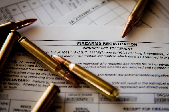 Six 5.56 cartridges sit on top of an AF Form 1314 Firearms Registration form and a DD Form 2760 Qualification to Possess Firearms or Ammunitions form at Minot Air Force Base, N.D., July 10, 2015. According to Staff Sgt. Justin McCoy, 5th Security Forces Squadron assistant NCO in charge of armory operations, if you reside in base housing, you are authorized by the installation commander to keep your personally owned weapons in your home, provided you register them with the 5th SFS Armory. (U.S. Air Force photo/Airman 1st Class Justin T. Armstrong)