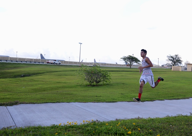 Isaac Ventura, race participant, runs toward the finish line during the Reggae 5K run July 16, 2015, at Andersen Air Force Base, Guam. Ventura took first place with a time of 18 minutes, 28 seconds. (U.S. Air Force photo by Airman 1st Class Arielle Vasquez/Released)