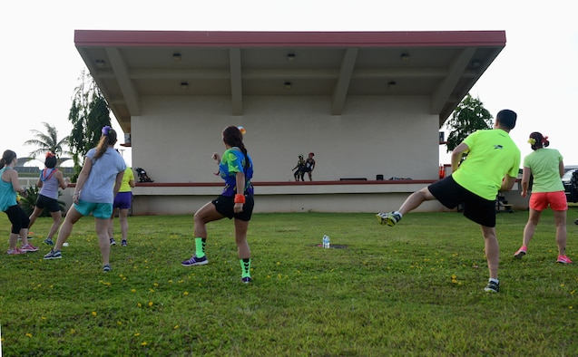 Runners participate in a warm-up before the Reggae 5K run July 16, 2015, at Andersen Air Force Base, Guam. Approximately 80 participants competed in the reggae-themed 5K run organized by the 36th Force Support Squadron. (U.S. Air Force photo by Airman 1st Class Arielle Vasquez/Released)
