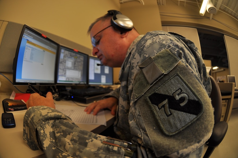 In this image released by the 75th Training Command, Army Reserve soldiers and contractors with the unit's Southern Division operate a computer-based simulation training exercise in Houston, Texas, Saturday, Oct. 20, 2012. The exercise was part of an effort to demonstrate a system developed by the 75th to allow various military units to conduct certain types of scenario-based 'war game' training over computer networks. In this exercise, the unit undergoing the training was located in Louisiana, while one small team – pictured here – transmitted the fictional scenario via network and phone. This format allows units to train in leadership and mission management tasks with a high degree of realism, and a low overall cost.  (Photo/75th Training Command, Army Reserve Maj. Adam Collett)