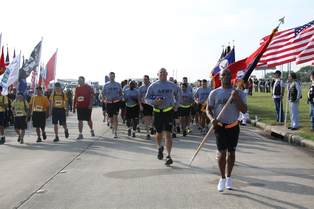 In this image released by the U.S. Army Reserve, soldiers with the 75th Training Command participate in a charity fundraising race in Houston, Texas, Saturday, Sept. 8, 2012. While the primary wave of the race included mostly civilian participants competing individually, the 75th supported the event by conducting a group formation run behind the first wave. Events such as this race allow the 75th to emphasize both physical fitness and community engagement. (Photo/75th Training Command, Army Reserve Sgt. 1st Class Johnnie Beatty)
