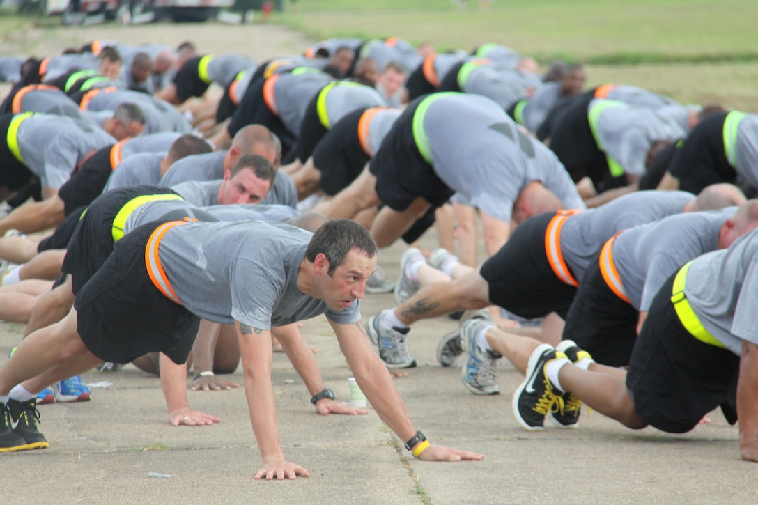 In this image released by the U.S. Army Reserve, soldiers with the 75th Training Command cool down after conducting a group formation run as part of a charity race in Houston, Texas, Saturday, Sept. 8, 2012. The race, dubbed the 9-11 Heroes Run, benefited the Travis Manion Foundation. The unit incorporated the event into its monthly training weekend in an effort to support the local community and to partner with public safety agencies. The 75th's commander, Maj. Gen. Jimmie Jaye Wells, addressed the troops after leading them in the run. (Photo/75th Training Command, Army Reserve Sgt. 1st Class Johnnie Beatty)