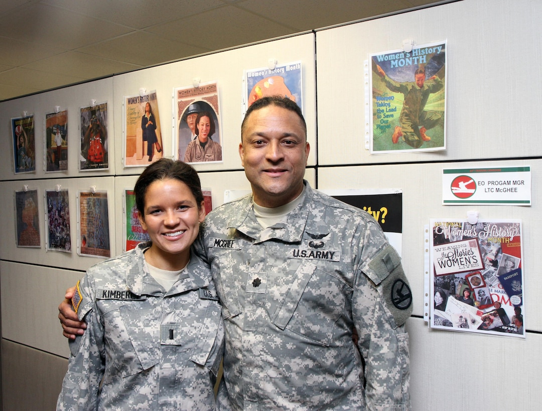Lt. Col. Andreas J. McGhee, Equal Opportunity Program manager, Army Reserve 84th Training Command, Fort Knox, Ky., shares a moment with his daughter, 1st Lt. Andria Kimberly, an Army Reservist with the 801st Combat Support Hospital, Indianapolis, at the Command's Headquarters March 14, 2015. (U.S. Army Photo by Sgt. 1st Class Clinton Wood, 84th Training Command Public Affairs/Released)