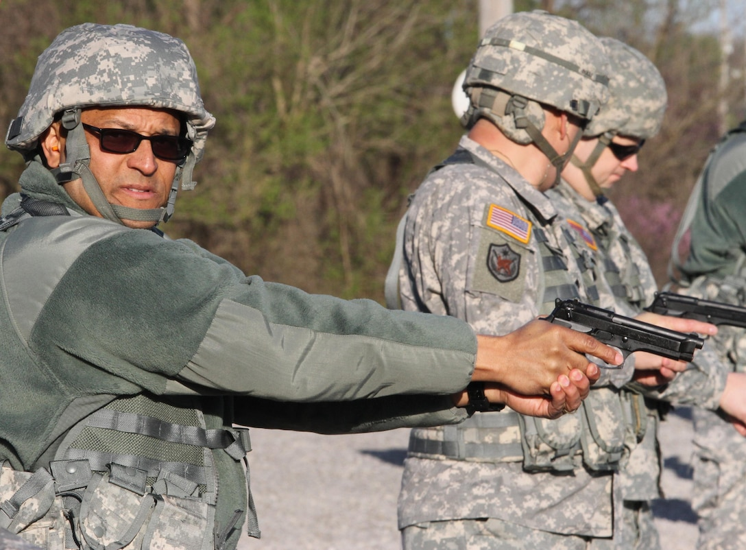 Lt. Col. Andreas J. McGhee, Equal Opportunity Program manager, Army Reserve 84th Training Command, Fort Knox, Ky., waits for the command to fire his M9 semi-automatic pistol during the Command Headquarters and Headquarters Company's range qualification day at Fort Knox, Ky., March 11, 2015. (U.S. Army Photo by Sgt. 1st Class Clinton Wood, 84th Training Command Public Affairs/Released)