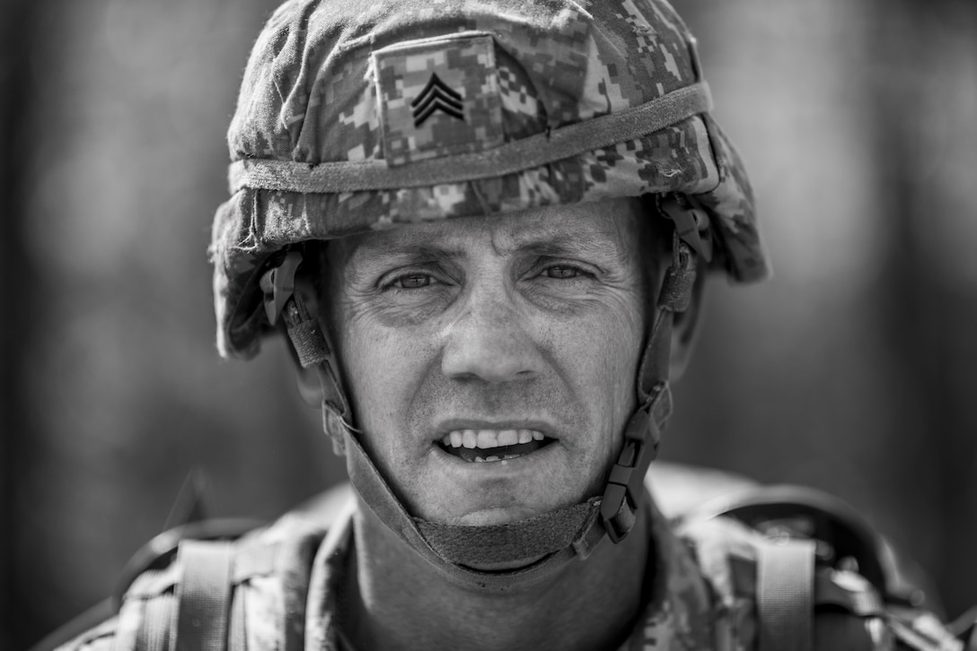 Sgt. Dee McMurdo, from Bellevue, Idaho, with the 11th Battalion (Observer/Controller Trainer), stands for a portrait after finishing a 10-kilometer foot march in the North Carolina heat May 5 during the 2015 Army Reserve Best Warrior Competition at Fort Bragg. This year's Best Warrior Competition will determine the top noncommissioned officer and junior enlisted Soldier who will represent the Army Reserve in the Department of the Army Best Warrior Competition later this year at Fort Lee, Va. (U.S. Army photo by Sgt. 1st Class Michel Sauret)