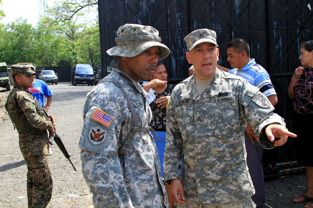 Army Sgt. David N. Arrieta, a Houston native with the 451st Civil Affairs Battalion, gives a situation report to Sgt. 1st Class Thaddeus U. Brazelton, also from the 451st Civil Affairs Battalion, during a Medical Readiness Training Exercise as part of Beyond the Horizon, May 11. BTH is a combined medical and engineer mission that provides humanitarian assistance to the people of El Salvador. (U.S. Army photo by Sgt. Rigo Cisneros)