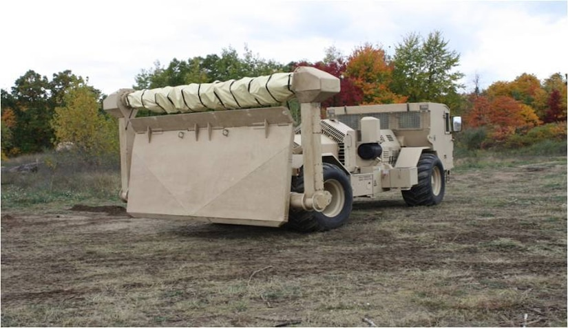 An M1271 Medium Flail Mine Clearing Vehicle is equipped with a rotating flail and 72 chains with fist-sized balls, or hammers, at the end of the chains. As the vehicle drives backwards over the designated area, the flail rotates and the chains dig into the ground tearing mines apart or detonating them. The driver is protected by a deflector shield of armored steel, protecting the both the driver and vehicle against blast pressure and mine fragments. (Courtesy photo/USARC G4)