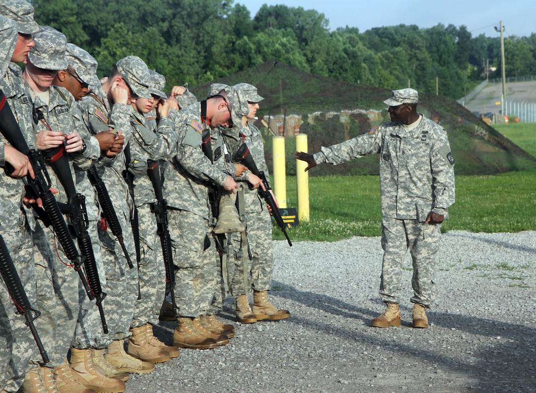 Sgt. 1st Class Anthony Lacy, a U.S. Army Reserve Officer Training Course instructor at the University of Cincinnati, guides cadets of Company A, 6th Regiment, through preparations for their weapons qualification at Blair Range, Fort Knox, Ky., July 11, 2015. Weapon range safety is among the many responsibilities senior noncommissioned officers carry, ensuring these future leaders learn by their example. (U.S. Army photo by Sgt. Javier Amador)