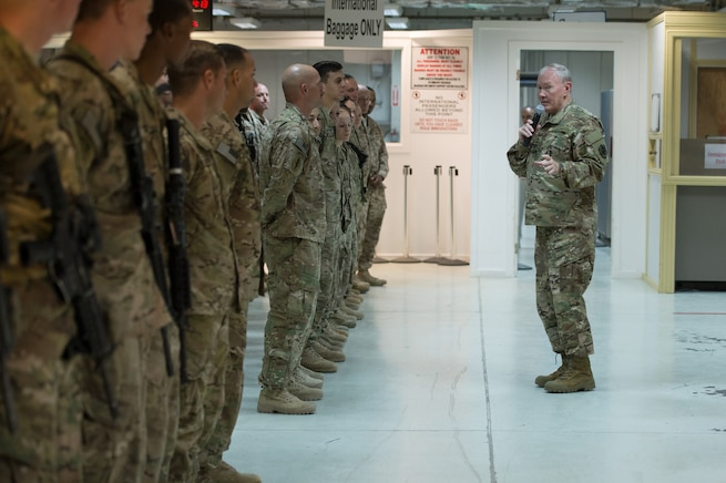 U.S. Army Gen. Martin E. Dempsey, chairman of the Joint Chiefs of Staff, talks with service members deployed to Iraq during a town hall in Baghdad, July 18, 2015.