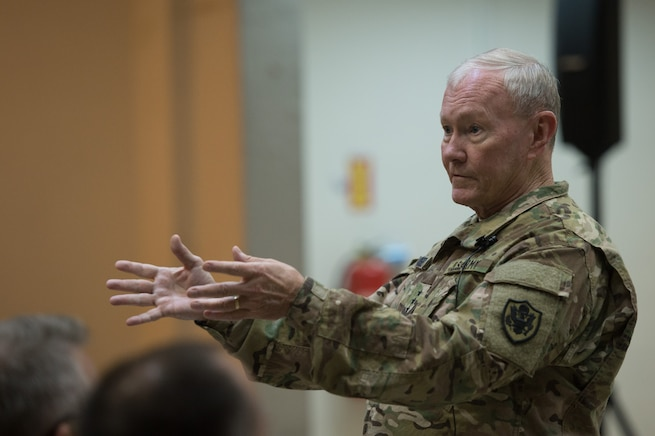 U.S. Army Gen. Martin E. Dempsey, chairman of the Joint Chiefs of Staff, talks with service members deployed to Iraq during town hall in Baghdad, July 18, 2015.