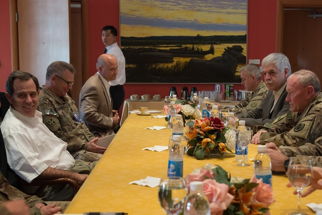 U.S. Army Gen. Martin E. Dempsey, chairman of the Joint Chiefs of Staff, and his staff meet for a strategy session with Stuart E. Jones, U.S. ambassador to Iraq, in Baghdad,  July 18, 2015.