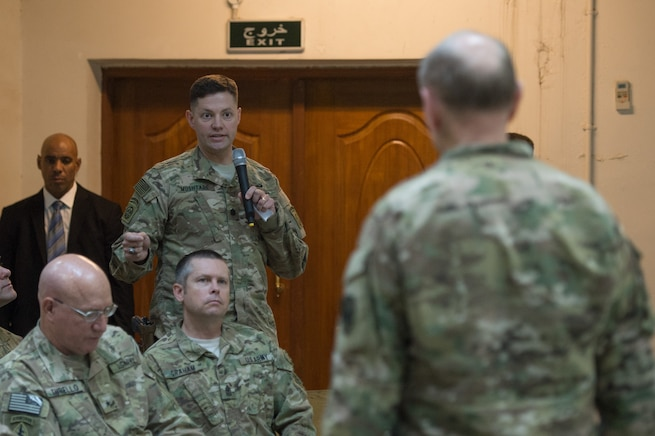 U.S. Army Gen. Martin E. Dempsey, chairman of the Joint Chiefs of Staff, takes a question from a service member deployed to Iraq during town hall in Baghdad, July 18, 2015.