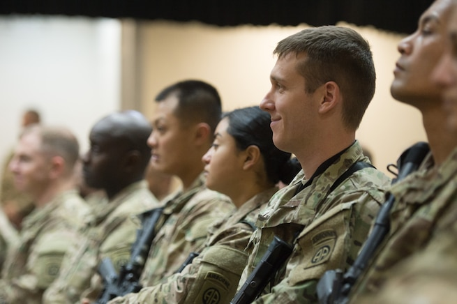 Service members listen as U.S. Army Gen. Martin E. Dempsey, chairman of the Joint Chiefs of Staff, answers questions from service members deployed to Iraq during a town hall in Baghdad, July 18, 2015.