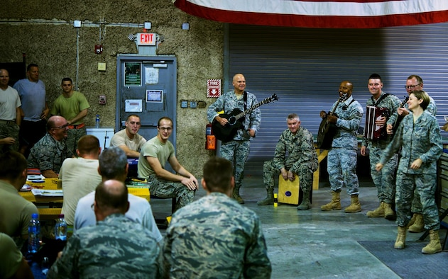 The U.S. Air Forces Central Command band plays music for service members during a performance at Al Udeid Air Base, Qatar, June 17, 2015. The band visited workstations to perform and boost Airmen's morale. (U.S. Air Force photo/Airman 1st Class Nathan Martin)