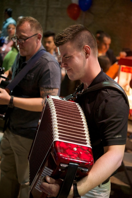 Airman 1st Class Cody Peterson, a U.S. Air Forces Central Command band keyboardist, plays an accordion during a performance at the American Language Center in Amman, Jordan, July 1, 2015. The center partnered with the U.S. Embassy to teach the local communities about Fourth of July traditions in America. The AFCENT band supported the event by providing popular American music for the local community's enjoyment. (U.S. Air Force photo/Airman 1st Class Nathan Martin)